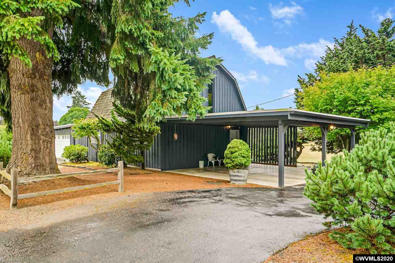 Super cute and cozy home on 1.56 acres is ready for viewing by appt only. The home is unique and one of a kind featuring an open floor plan, barn feel. Upon entry you will see the centrally located fireplace in the LR, large kitchen with ample storage, formal dining area and a slider to the deck. 2 bedrooms, 2 bath and 1922 Sq ft. Attached large 2 car garage in addition to the large carport. Don't miss the large shop as well! Call today for your appt!