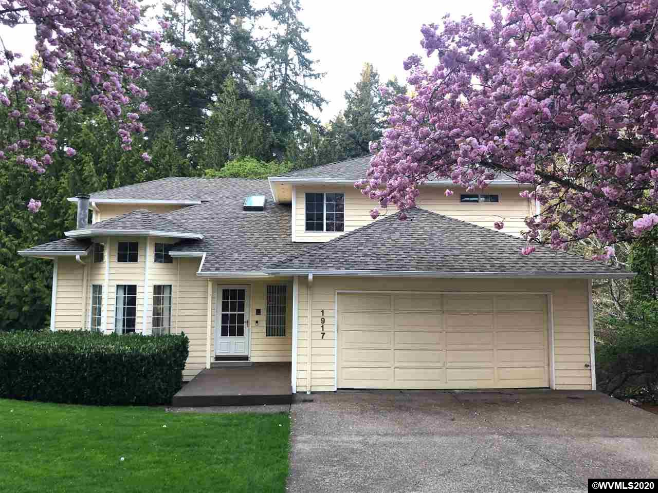 Come Home to this Beauty located in the desirable Forest Heights! Large Vaulted Living Room boasts Window-Seat, Fireplace & Formal Dining. Spacious Kitchen opens to Family Room w/Cozy Fireplace. Main Level Laundry too! Spoil yourself with Tree-House Views from MB Suite w/Jetted Tub & enormous Walk-in Closet+ Stack-able Laundry. 1000+ Sf Basement includes Theater/Rec Rm, Workout/Office, 4th Bedroom & oodles of Storage. Revel in Nature from your Deck while you entertain or relax in your Private Oasis.