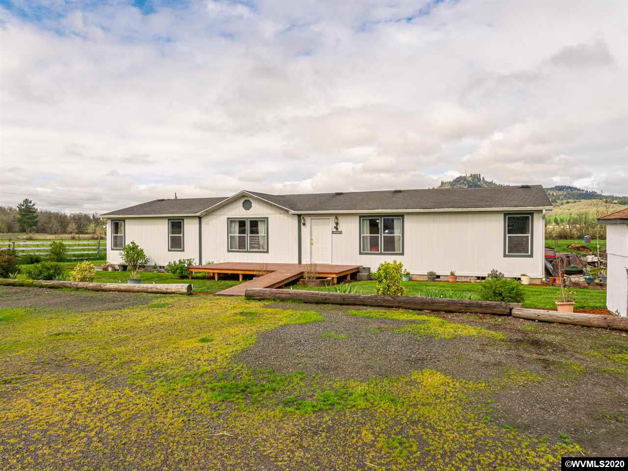 Beautiful country setting & views of Peterson Butte just minutes from town! This 5 acre property is flat, usable, & has a 36x48 barn w/ 4 stalls & a 6' overhang on one side making it great for animals. The spacious 2000+ sq. ft. home has both living & family rooms & a den that could be used as an additional bedroom. The large master has dual sinks, soaking tub, separate walk-in shower, linen storage, & walk-in closet. Complete w/ forced air heat & central A/C. Desirable area & wonderful commuter location.