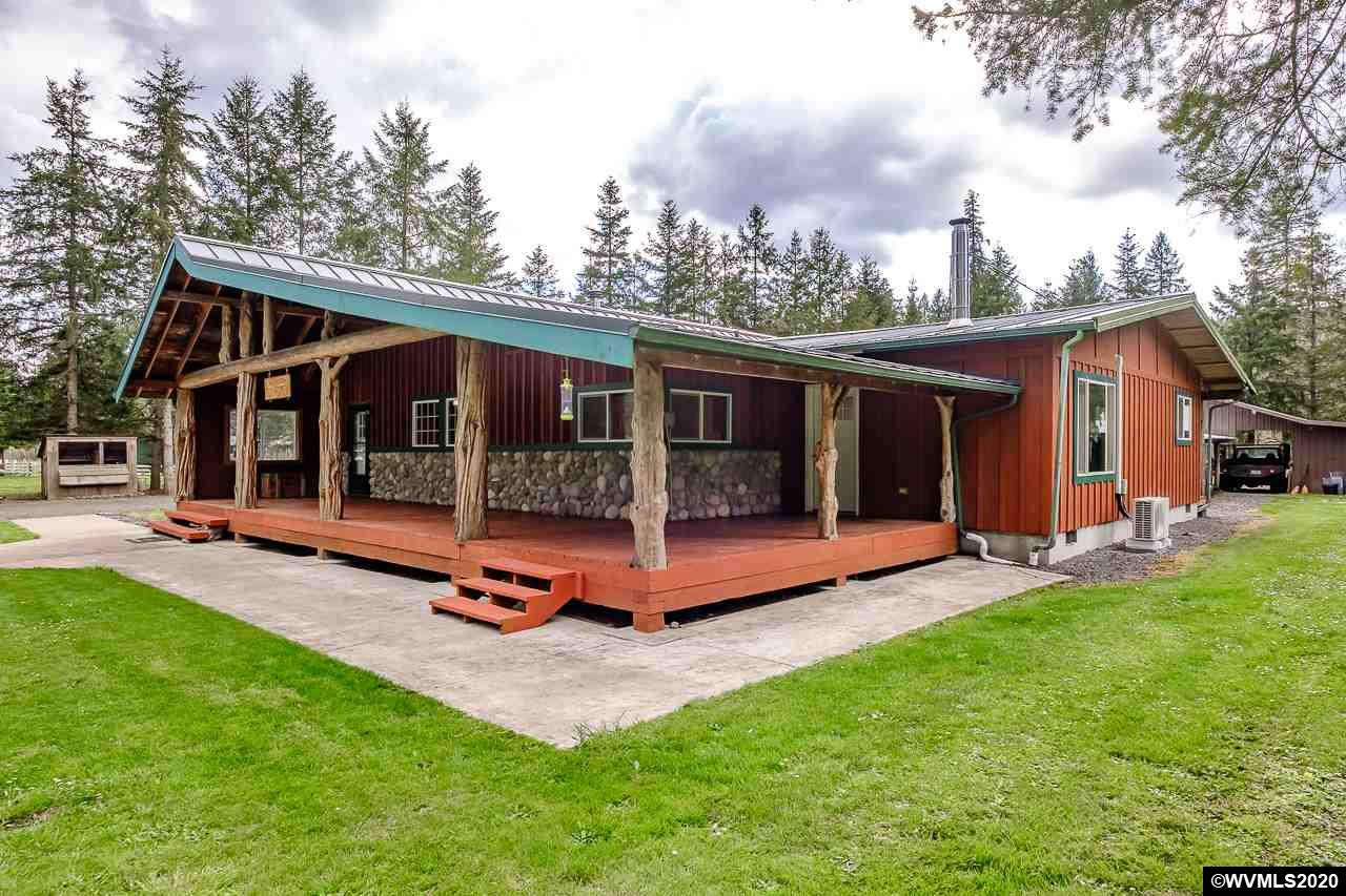 Beautiful custom remodeled home! New bathrooms and flooring. 3 year old roof, vinyl windows. Personal pond with waterfall, pond house, 2 large shops, with lean-to storage on each. There are 2 additional heated rooms attached to the shop and also a personal meat cooler. Sits on Hamilton Creek with 29 year old Privacy trees throughout, turnabout, woodshed. Too many things to list!