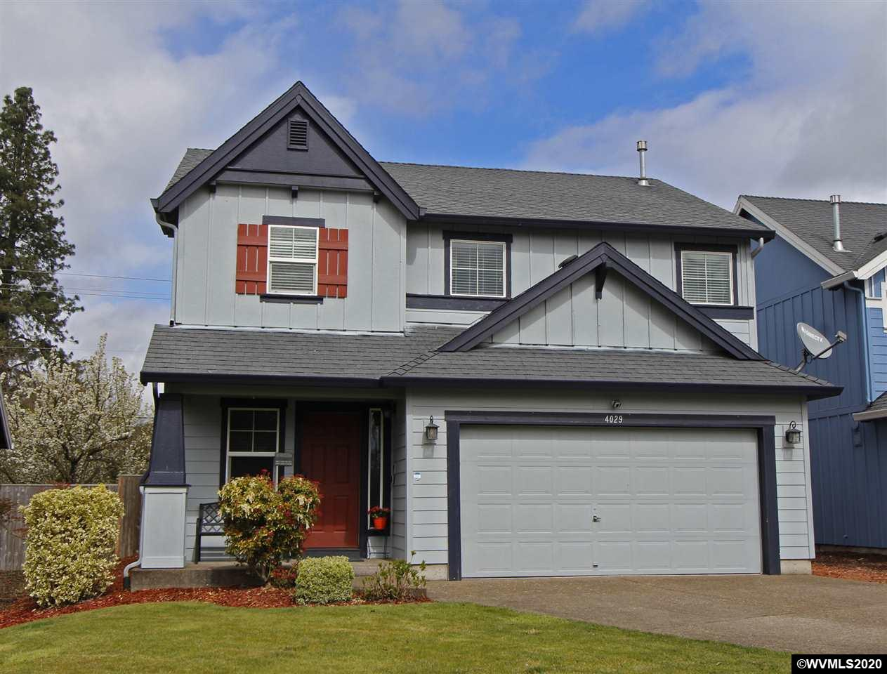 Beautifully updated this wonderful home features newer vinyl plank flooring in the main living area, a gas fireplace & neutral paint colors.  The counters are upgraded with tile while the outdoor space is lovely featuring a large patio plus a nice deck with a full cover so you can enjoy the outdoors year round, rain or shine. The stairs access the living room for nice flow & the upper story features bedrooms and the utility area. Master suite features a nice walk in closet & a full bath. Plenty of parking.