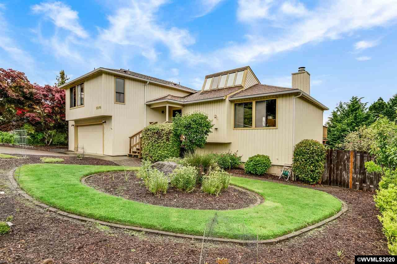 WOW! Perfect location & ideal for the home gardener w/ an added bonus of Cascade VIEWS! This 5 BR home offers a new direction for city living!  Gorgeous view lot on quiet street in popular NW location. Lots of versatility in the multi-level home w/cozy fireplace in formal LR. Formal dining & area in kitchen. Multi-decks off FR & Kitchen offers outstanding views to the east of mountains & sunrises & rear yard. Wonderfully landscaped yard with extensive vegetation, fruit trees & garden/herb space.
