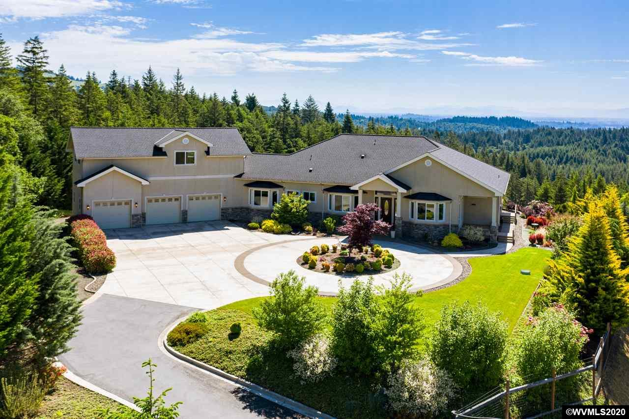 A dream come true! Soak up the best views in the valley all year long! Custom build luxury construction and panoramic views of Marys Peak and surrounding area make it the perfect place to call home. Meticulously cared for inside & out, including master Gardner-inspired and designed landscaping.
