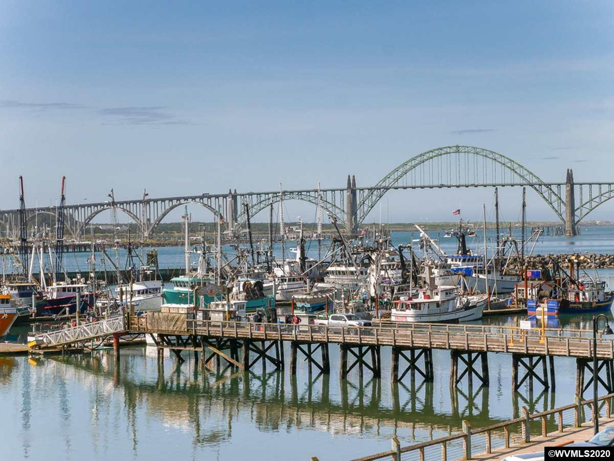 A rare find! Luxury home w/all-encompassing views of the Yaquina Bay, Docks, Bridge & sea! No obstruction-a true 'picture' window! Extensive custom features & attention to details.Walls of windows. Lg. floor tiles. Vaulted Great Rm, gas fp & big open space.Dining w/deck access, lg kitchen w/extensive cherry cabinetry & built-ins, granite counters & pantry.Generous mstr suite, spacious bathroom & walk-in closet. 2 bdrms w/sliders. One owner,well maintained. Short block walk to restaurants & shops. One owner.