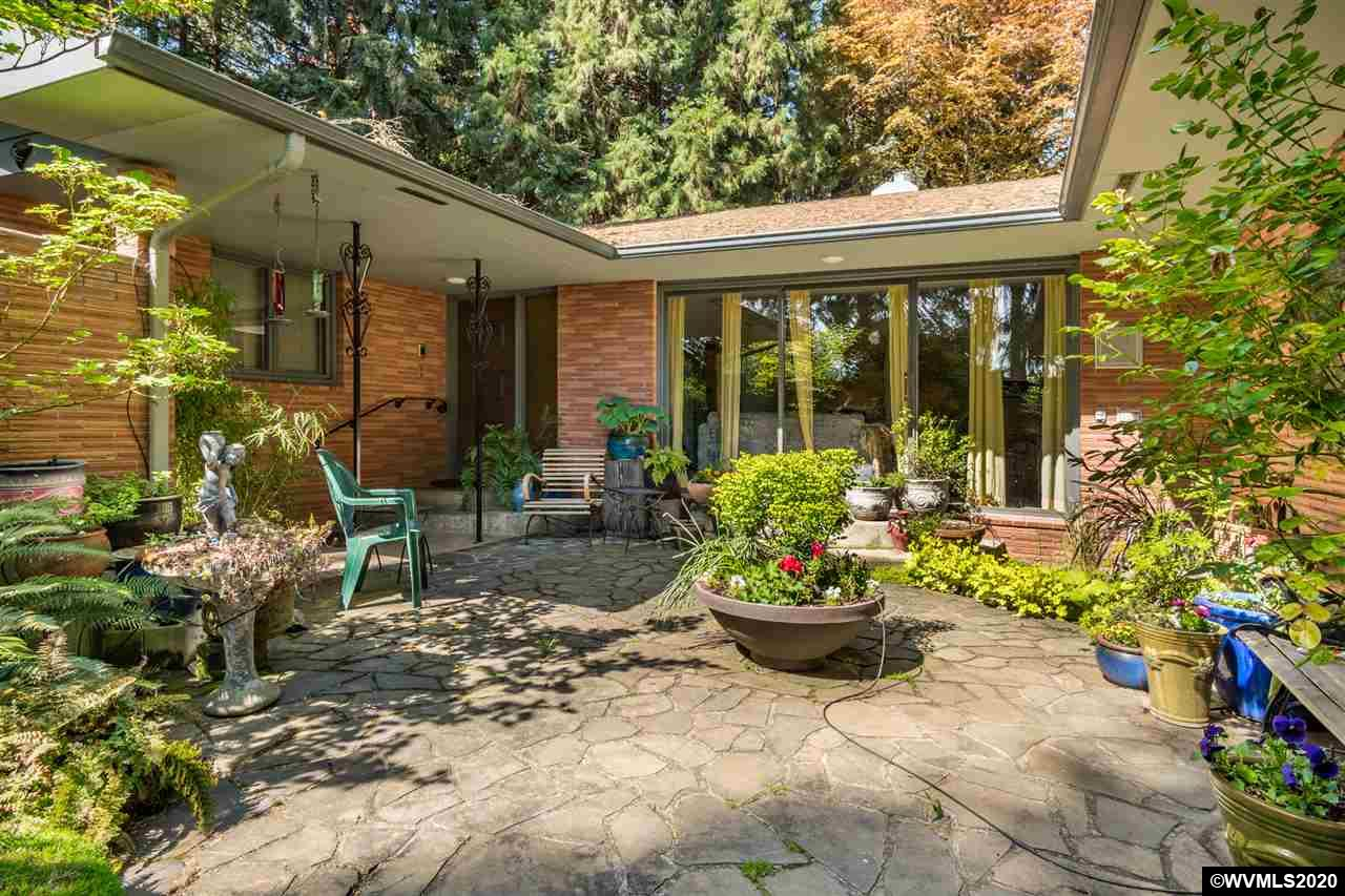 Set on a private dead-end lane, this solid one-level home is 2 lots for 2+ acres . Pastoral views just minutes from downtown & Hwy 20 to Corvallis. Lovely entry courtyard w/water feature, large living rm w/big picture windows. Kitchen w/SSA, double ovens, breakfast nook overlooks large private backyard. Family room w/gas fireplace & slider to covered patio. Spacious master suite. Separate wing w/two more bedrooms, guest bath. Laundry room w/sink, 1/2 bath. Garage w/tons of storage. RV parking. NO drive-bys.