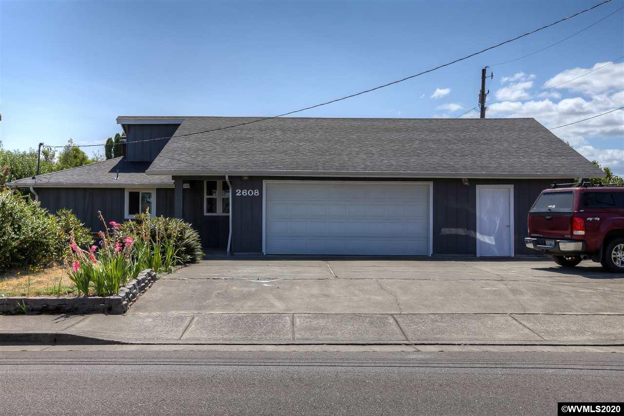 Shop space galore!  2 workshop areas and extra room in the garage for woodworking, crafting, or getting creative. Solid home with plenty of interior space, large lot and great central location.  Bring your finishing touches to make this home yours!