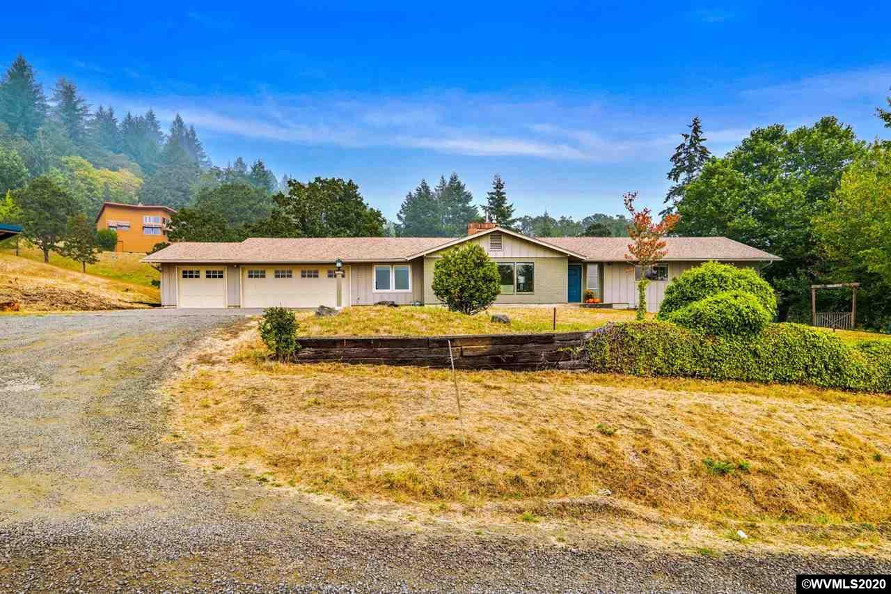 Classic Ranch with stylish updates, remodeled open kitchen, daylight basement, potential dual living, 3 living areas, formal & informal dining, 3 car garage & an incredible view of  the Coast Range on a 2 acre parcel minutes from town and easy access to  Bald Hill & other scenic trails. Master with en-suite, 2 bedrooms and full bath on main floor.  Daylight basement with large family room, two more bedrooms, full bath, studio & 500sf of storage. Fenced for animals, productive garden beds and fruit trees.