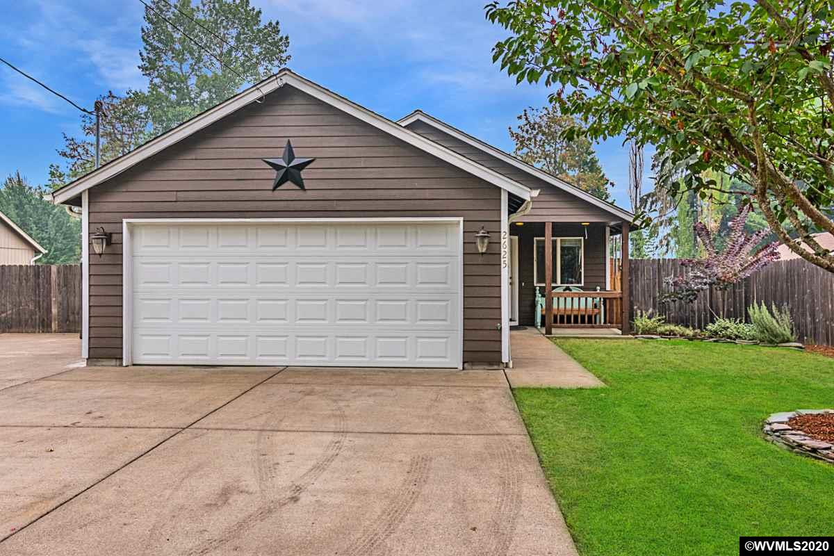 COME HOME TODAY! Beautiful landscaped setting for this charming home! 3 bedrooms, 2 bathrooms, in a peaceful neighborhood, nice open floor plan, central AC, separate 16x12 SHOP with power, relaxing covered back patio, fully fenced nice size yard, room for RV parking, and so MUCH MORE! Don't sleep on your chance to make this one yours!!
