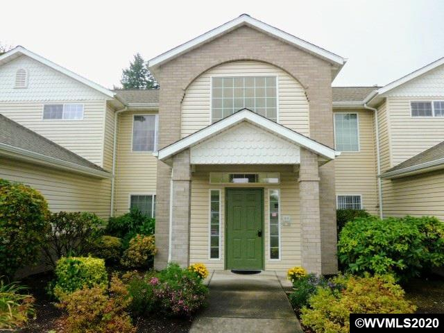 2 bed 2 bath well maintained condo has much to offer w/ open floor plan, gas fireplace in living room, vaulted ceilings, granite & tile countertops, large farmhouse sink in kitchen, & single car garage. Lovingly customized w/ beautiful accent tile in bathrooms & beadboard cabinets & trim throughout. Enjoy year-round comfort in this low maintenance home w/ gas forced air, central AC & lovely balcony off spacious living room. HOA covers landscaping, exterior building maint & garbage. Appliances incl!