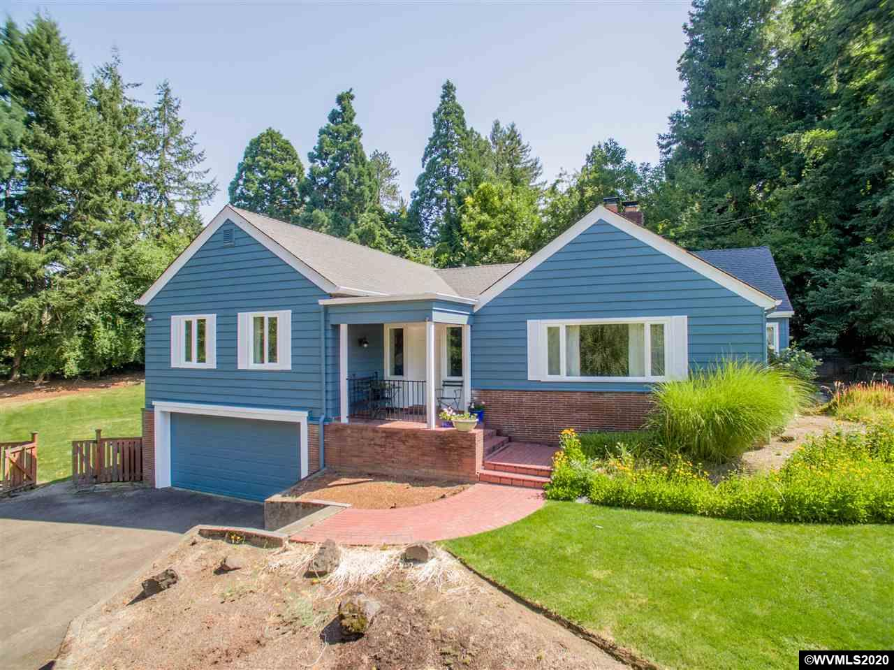 Corvallis gem 3 min to OSU on secluded .83 ac lot. 2nd owner home, maintained & renovated w/integrity of the period. Lrg living spaces, unique original features include custom built-ins, 2 Fireplaces, vintage cocktail bar & pecan HW floors. Also, for you allergy sufferers, this home has hot water radiator heat, no forced air heat here!! Don't miss the access to the upstairs attic space, add on a master suite or just extra strg. Also walk out unfinished bsmt. Must See!