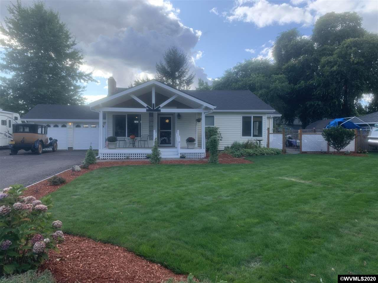 Cute updated home in nice SE neighborhood. Newer kitchen with custom cabinets, gas/electric range w/dual oven and coffee bar with 220 electric & water.  Master bedroom suite boasts newer master bath with dual shower stalls & walk-in handicap accessible area. Original refinished hardwood floors, fireplace double car garage, private well, RV space w/water and electrical hookups, large parking area, beautiful outdoor patio and landscaped areas and charm of the 1950s makes this the perfect move-in ready home.