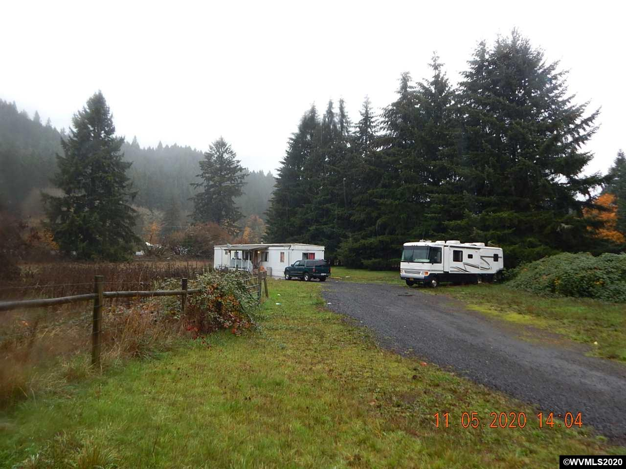 Accepted Offer with Contingencies. 1.50 acres with existing manufactured home.  Room for pasture, shop and a nice treed homesite.  Gravel pad already in place in ideal spot for shop.  Livable home or great affordable spot to build new.  Fully fenced lot with cross fenced pasture.  Seller will now consider carrying a contract with 6% rate, 15 year (or less) amortization & minimum of 20% down.