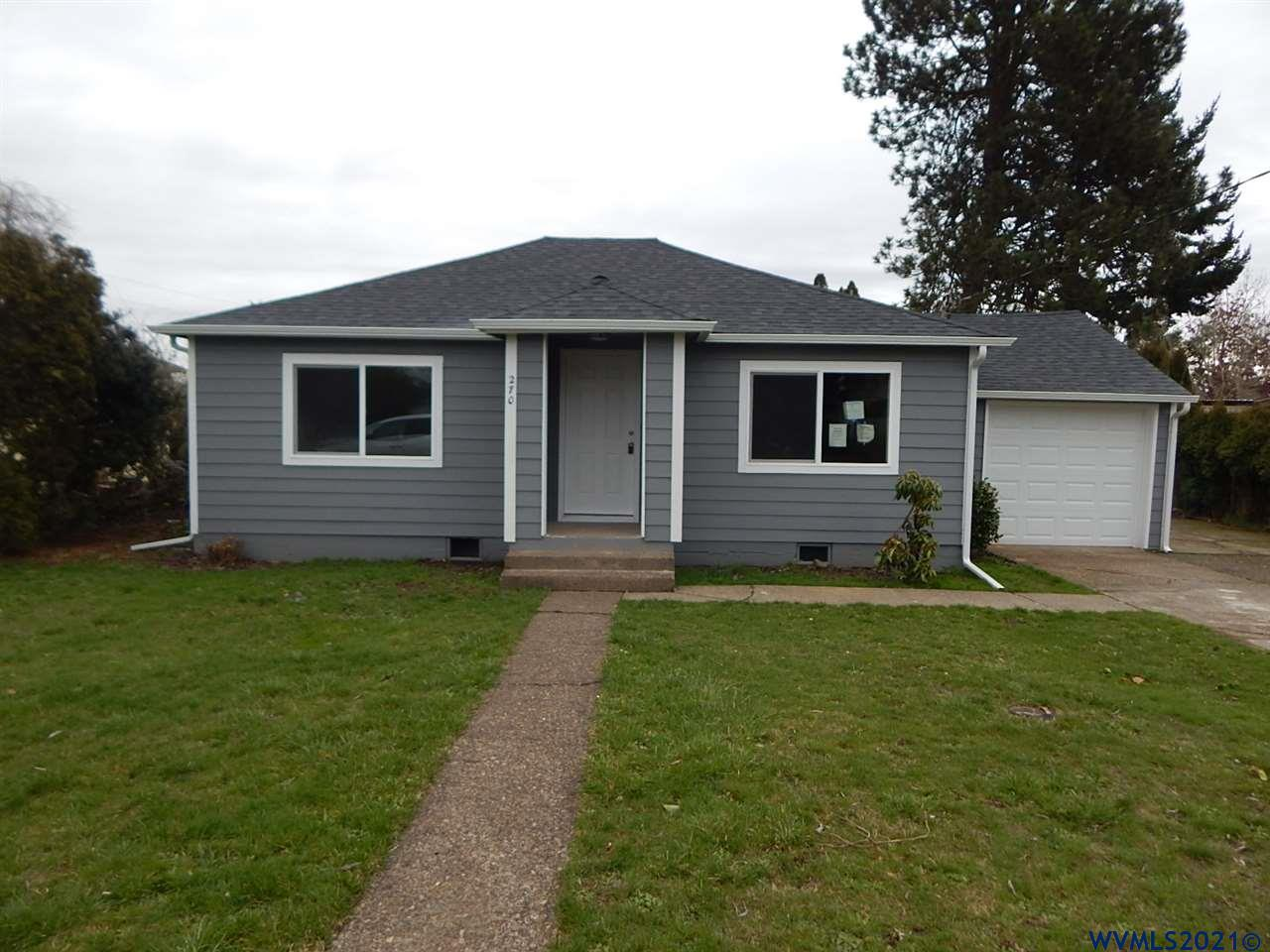 Totally renovated home is move in ready.  New kitchen, bathroom, refinished hardwood flooring, sheetrock with upgraded electrical & plumbing.  Huge fenced backyard on 170' deep lot.  RV parking area and possibly room to build a shop.  Exterior has new hardi plank siding, new roof, new windows & paint.  Low county taxes!
