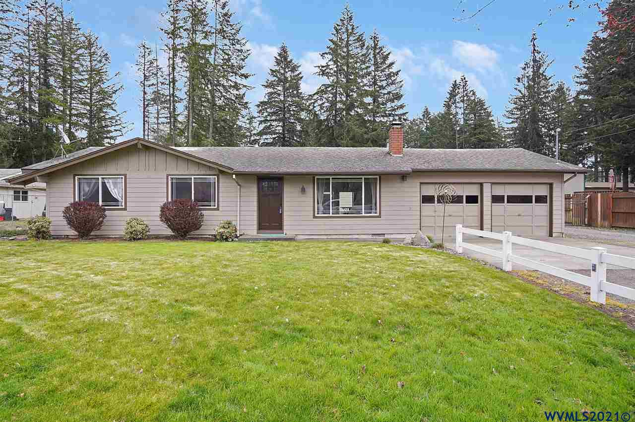 Accepted Offer with Contingencies. Dream Shop!  Shop built in 2002 is 32 x 42 (61 x32 including storage).  Shop has water, sound, lights, urinal & pellet stove.  House is nicely updated with hardi-plank siding, vinyl windows, luxury vinyl plank flooring, new trim & more.  Covered patio with custom stamped concrete.  Almost half acre lot with fully fenced backyard is sharply landscaped and has UG sprinklers.