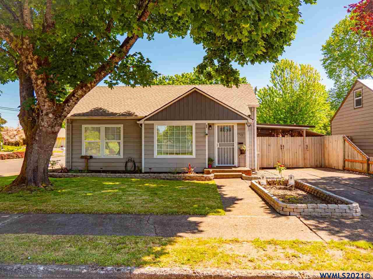 This beautiful little starter is updated & looking for new owners! Updates include windows, roof, laminate & tile flooring, tile surround in bath, recessed lighting & ceiling fan, etc. Sitting on an amazing corner lot w/ a spacious fenced backyard that includes gate access for trailer or RV parking, & a shed/workshop. Single carport off the kitchen can be used for parking or as a covered patio for additional outdoor enjoyment. The attic has potential to be converted to additional living space.