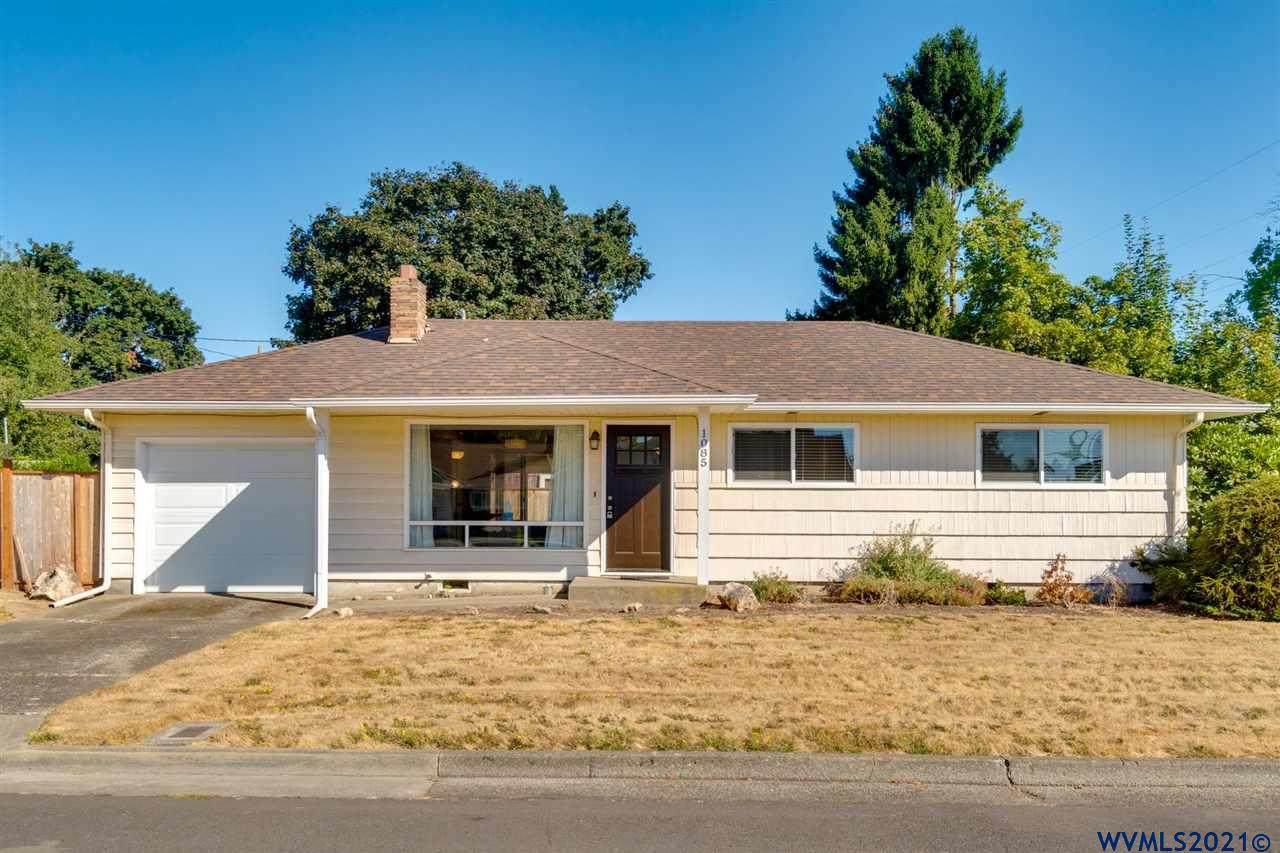 Very nice 3 bedroom starter home with everything you need. Nice floor plan with vaulted ceilings in living room & oak hardwood floors! Updated kitchen, large ss sink  painted cabinets, flooring, counters & subway tile backslash.  Electric, plumbing and windows updated in 2014. Desirable location with great corner lot. Room for Shop, RV or future ADU. This is a great opportunity. Buyer to due diligence with city on usage.