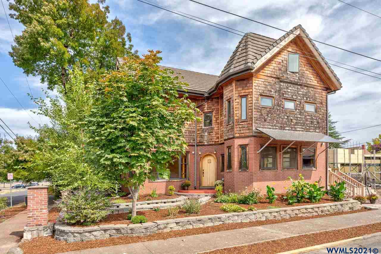"""Custom Neo-Edwardian home elegantly & innovatively blends eco-conscious modern construction with historic charm. Built to the highest standards, lovingly """"over-engineered,"""" with impressive foresight for adaptability. Solar panels, zero load-bearing interior walls, full high ceiling basement. Construction well under way for future owners to complete detached garage, with option for full apartment above. Stylish, extraordinarily energy-efficient/eco-friendly, and sweetly sentimental!"""