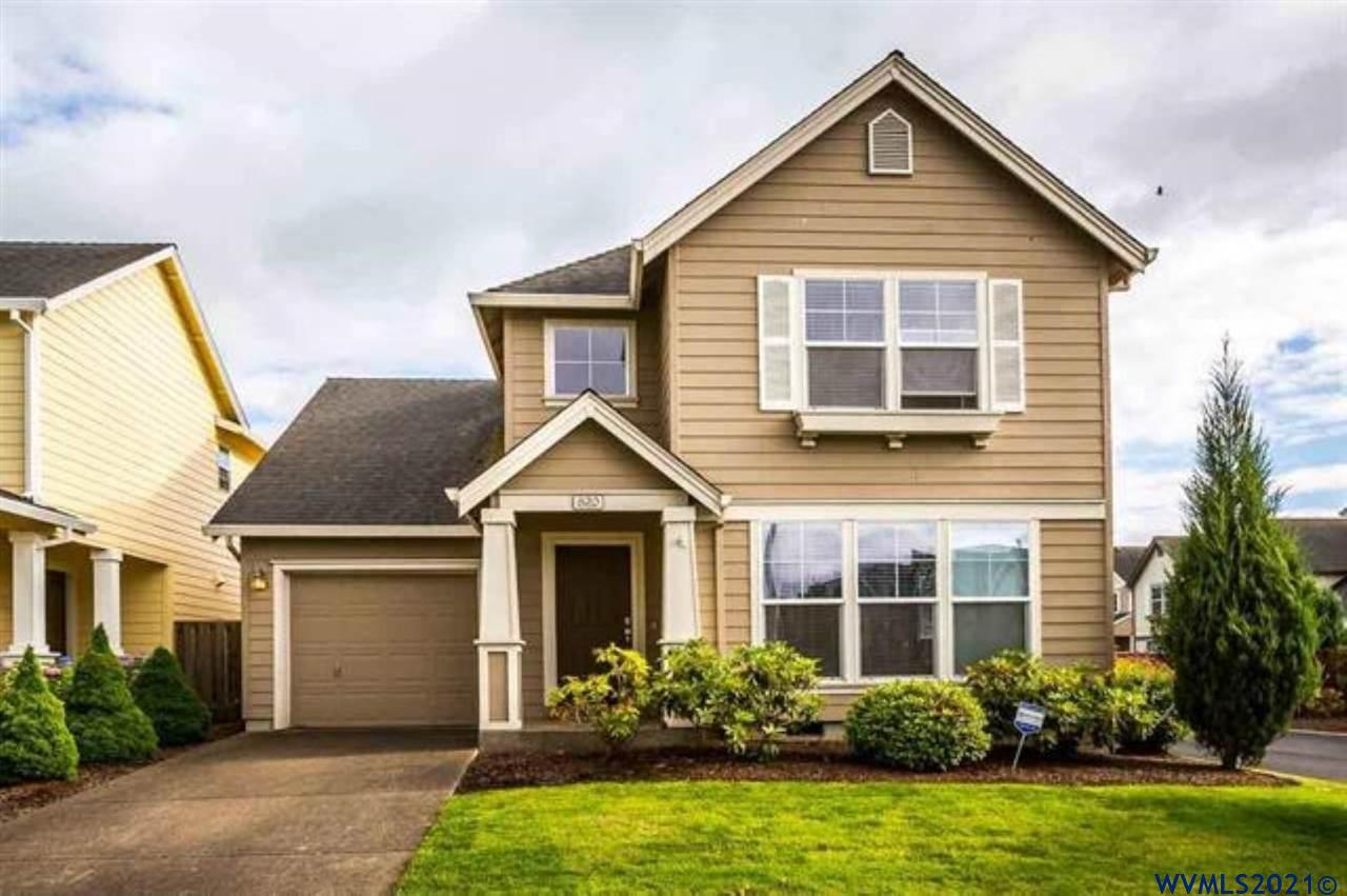 Wonderful 3 bedroom, 2.5 bath home in Willamette Landing with large fenced yard. Spacious floor plan includes huge kitchen, large bedrooms, ample storage and plenty of natural light. Enjoy the outdoors on the back patio and large fenced ard. Neighborhood amenities include swimming pool, fitness center and clubhouse. Low HOA dues. Has sprinklers in front yard. Central Heat and air. Is a green home.