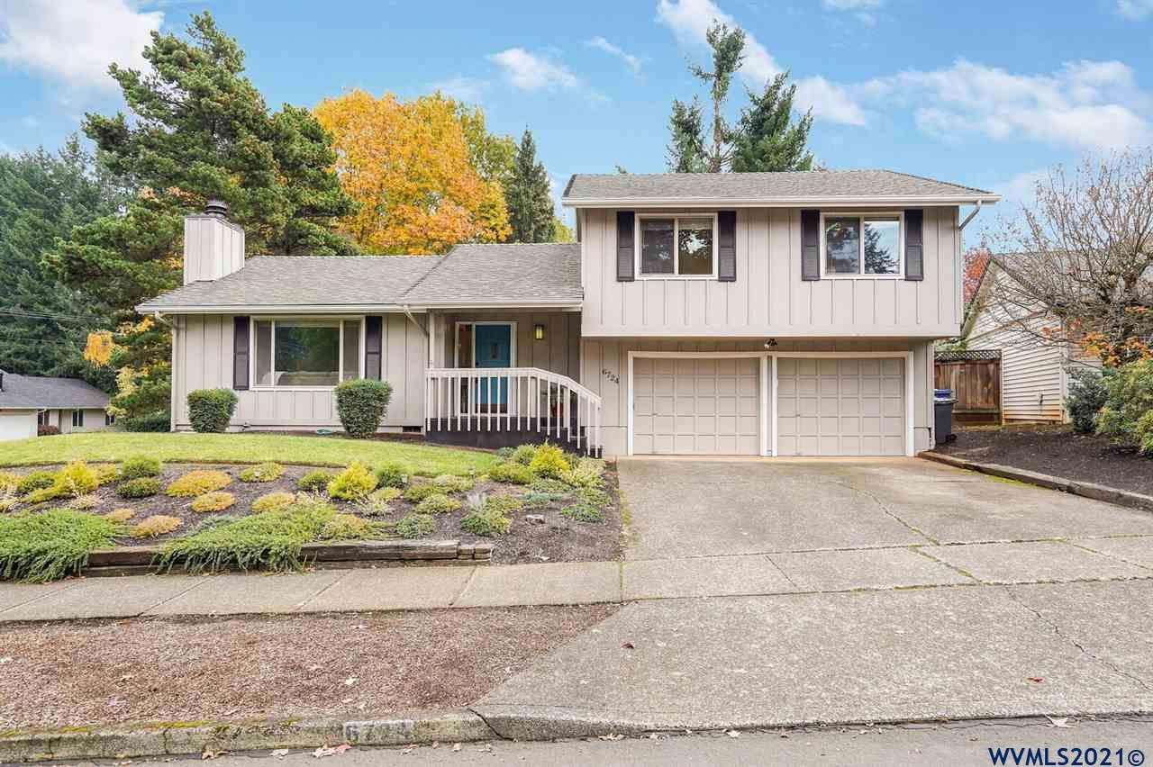 Accepted Offer with Contingencies. This property has the most beautiful backyard setting.  Large deck overlooks the spacious yard bordered by a pleasant year round creek.   Kitchen remodel just finished with quartz countertops, tile backsplash and updated cabinets.   Vaulted living room with fireplace.  Family room is open to kitchen & dining area.  Outstanding location next to Rees Park.