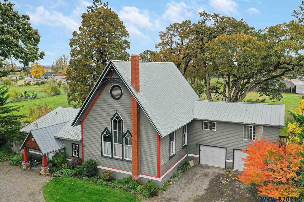 Historic church converted to a one of a kind home that has been lovingly preserved by an artist & craftsman.  There is extensive updating, but all done in a way that only adds to the immense character of the property.  New farmhouse style kitchen with leathered granite counters.  Main bathroom remodeled with period correct wainscoat and tile work.  True dual living with 1996 addition of 720 square foot 2 bedroom, 1 bath apartment above the garage.  Over half acre lot that backs up to park.